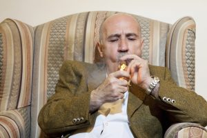 Business Man Smoking Acme Hemp Labs Cannagars